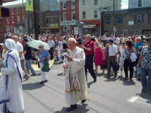 Monsignor Marine at procession